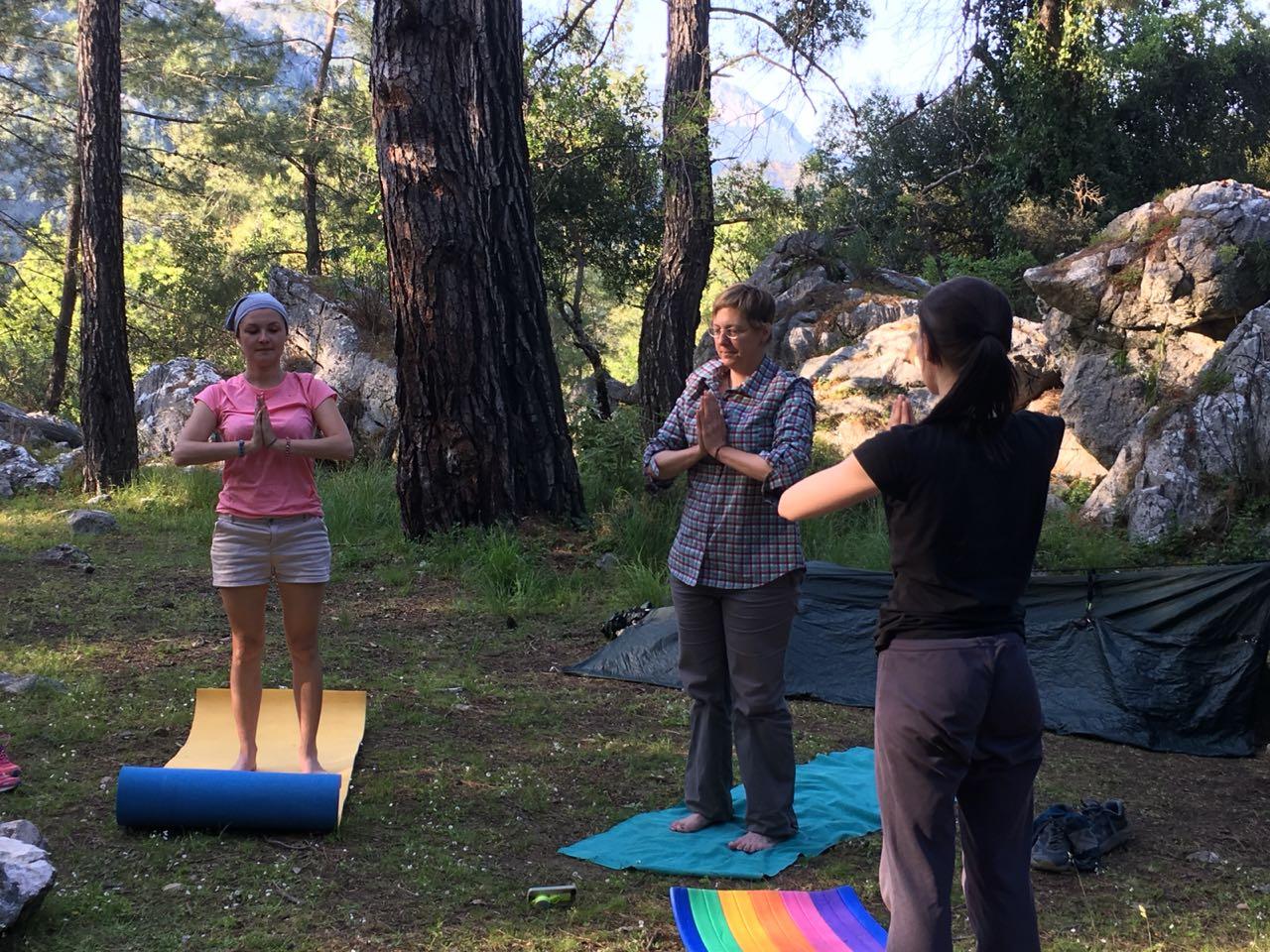 Campsite yoga. Photo courtesy of Elena and Kerell.