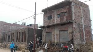 La casa en construcció. Vista frontal